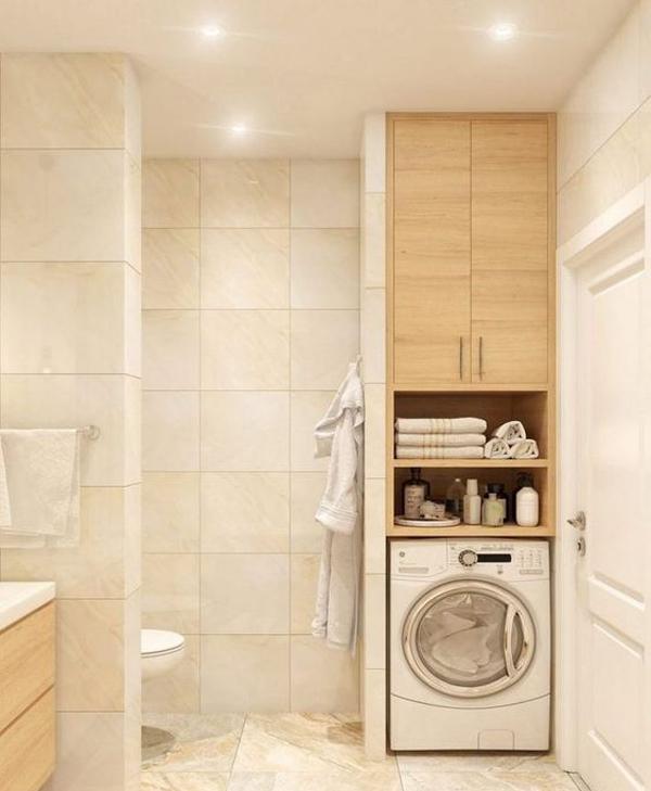 Colonna lavanderia in bagno con pensile sopra alla lavatrice
