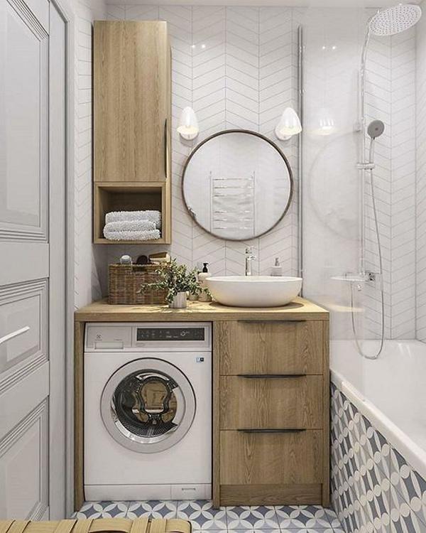 lavatrice coperta da una mensola che è anche base per il lavandino in bagno con piccolo pensile